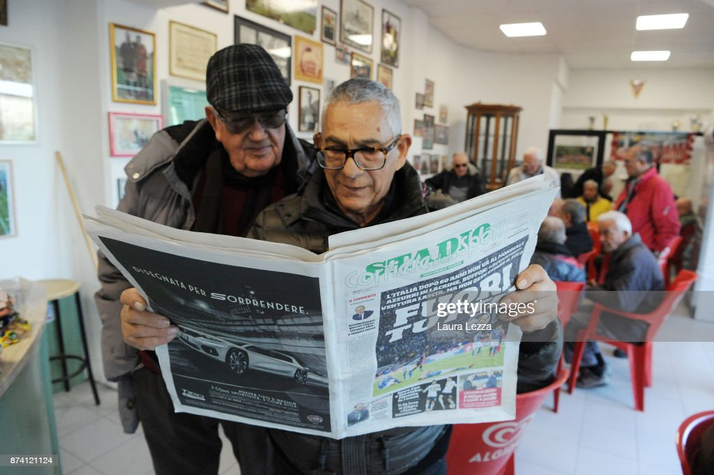 Men read Italian newspaper in a bar showing Italy soccer team defeat on its front pages the day after Italy failed to qualify for the World Cup 2018 on November 14, 2017 in Livorno, Italy. For the first time since 1958 Italy will not participate in the next World Cup in Russia, having been beaten by Sweden during the European qualifiers. The captain of the national team and goalkeeper Gianluigi Buffon between the tears came out saying that this defeat is also a social failure for Italy. There are many accusations and demands for resignations in Italy against all vertices of the Federation and the coach.