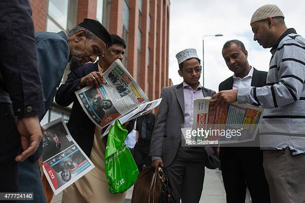 Men read newspapers outside the East London Mosque before attending the first Friday prayers of the Islamic holy month of Ramadan on June 19 2015 in...