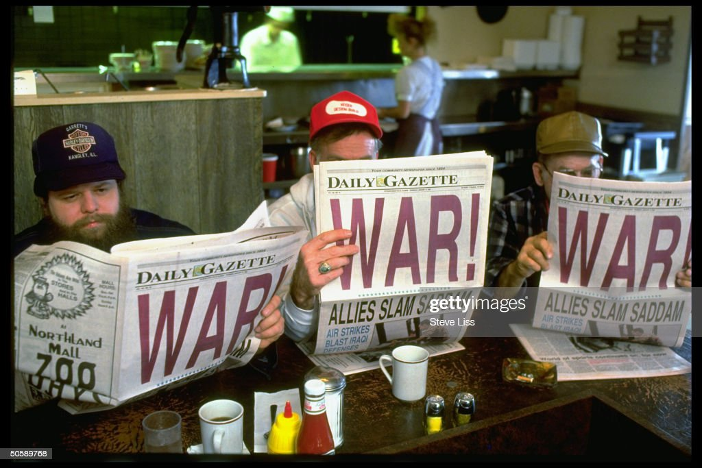 3 men reading local DAILY GAZETTE newspaper w. headline: WAR!, at Friendship House restaurant, on morning after Operation Desert Storm began.