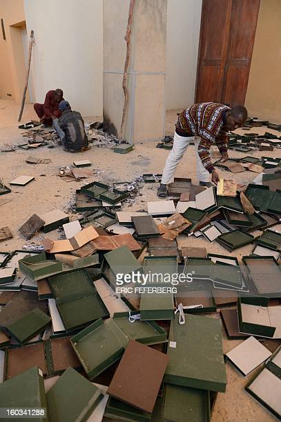 Men recover burnt ancient manuscripts at the Ahmed Baba Centre for Documentation and Research in Timbuktu on January 29 2013 Frenchled forces seized...