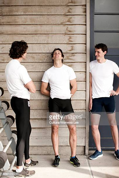 Men relaxing after workout