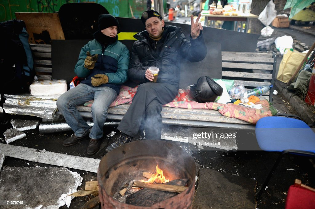 Men remain on front line barricades near to Independence Square on February 23, 2014 in Kiev, Ukraine. Prime Minister Yanukovych is said to have left Kiev for a eastern stronghold as the country's parliament voted to remove Yanukovych from office and call for new elections.