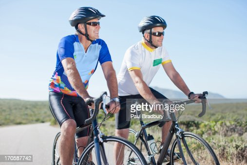 Men riding bicycles in remote area : Stock Photo
