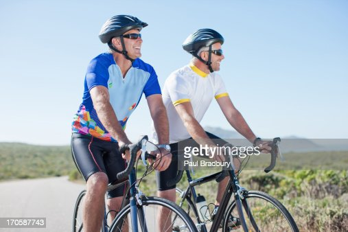 Men riding bicycles in remote area