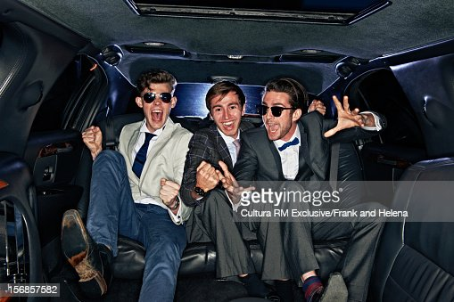 Men riding together in limousine