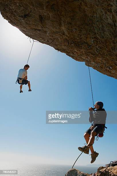 Men rock climbing