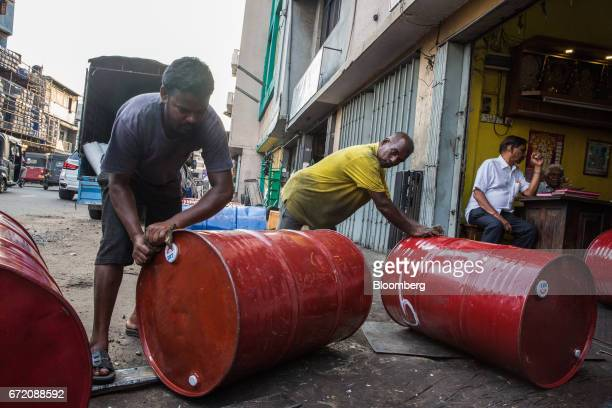 Men roll oil barrels into a store in the Pettah neighborhood of Colombo Sri Lanka on Thursday April 20 2017 The Central Bank of Sri Lanka is...