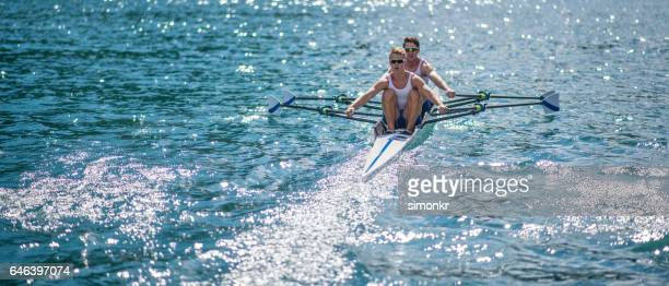 Men rowing boat