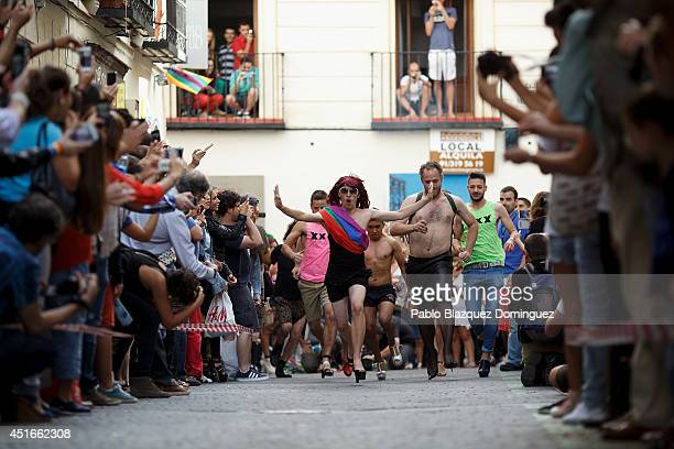 Men run at the annual highheel race during Madrid Gay Pride celebrations in a street of Chueca on July 3 2014 in Madrid Spain The winner of the race...