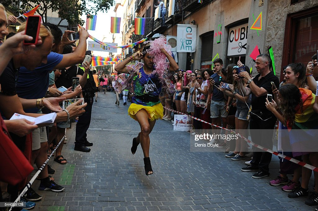 Men run down Pelayo street during the High Heels race as part of the 2016 Madrid Gay Pride week on June 30, 2016 in Madrid, Spain. Hundreds of thousands of revellers celebrate the Gay Pride week in Madrid, one of the biggest in Europe.