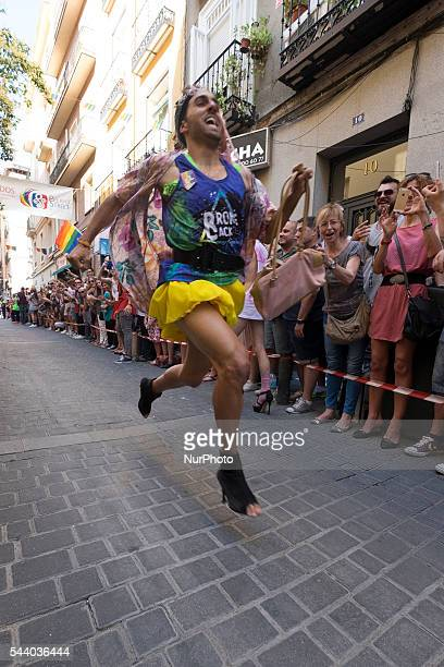 Men run down Pelayo street during the High Heels race as part of the 2016 Madrid Gay Pride week on June 30 2016 in Madrid Spain Hundreds of thousands...