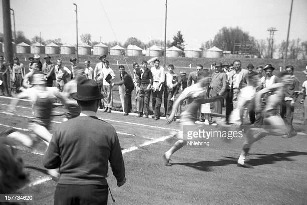 men running in high school track event 1941, retro
