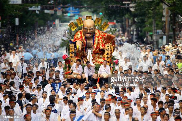Men runs with a Hikiyama float during the 'Shudan Kaomise' event as a part of the Hakata Gion Yamakasa on July 13 2017 in Fukuoka Japan The Yamakasa...
