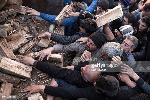 Men scramble for firewood after a truck brought five tonnes to the Idomeni refugee camp on the GreekMacedonia border on March 06 2016 in Idomeni...