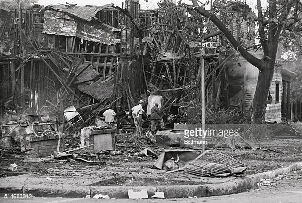 Men search through the ruins of building burned during a fire in Birmingham Alabama sparked by racial tension
