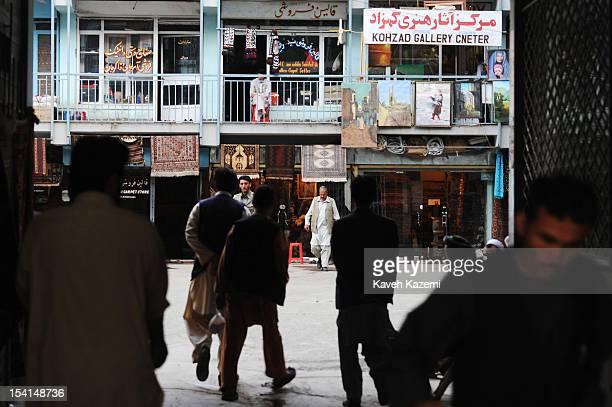 Men seen during daily activities of the rugs market in Chicken Street on October 17 2011 in Kabul Afghanistan Chicken Street has been a focus for...