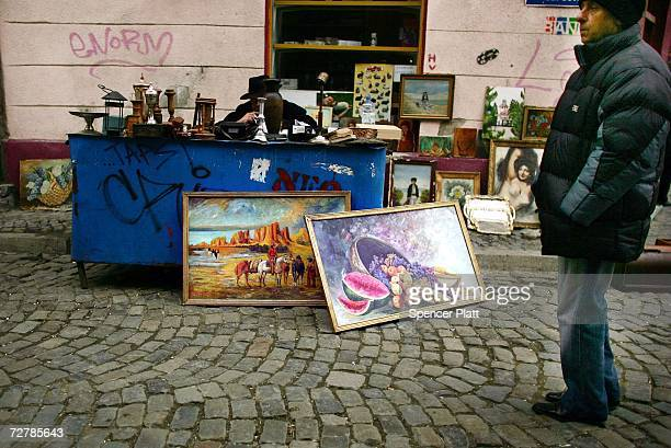 Men sell art and various sundry items on the street December 9 2006 in Bucharest Romania Romania a country of over 21 million people that is set to...