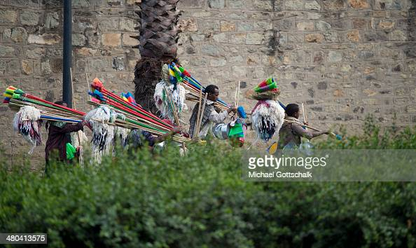 Men selling brooms walk on the street on March 24 2014 in Addis Abeba Ethiopia