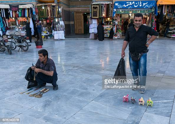 Men selling iron chains for children and toys in Fatima alMasumeh shrine during Muharram Central County Qom Iran on October 8 2016 in Qom Iran