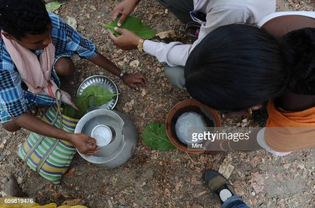 Men selling local drink called taadi in Bastar a maoist area on March 25 2010 in Chhattisgarh India