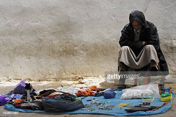 A men sells sewing accessories at the market Madina Jadida on April 9 in Oran Algeria