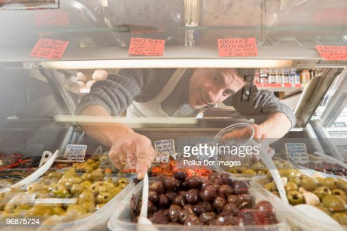 Men serving food from display case