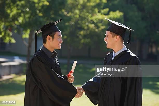 Men shaking hands at graduation