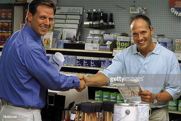 Men shaking hands in hardware store