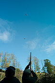 Men shooting grouse, Berwickshire, Scotland