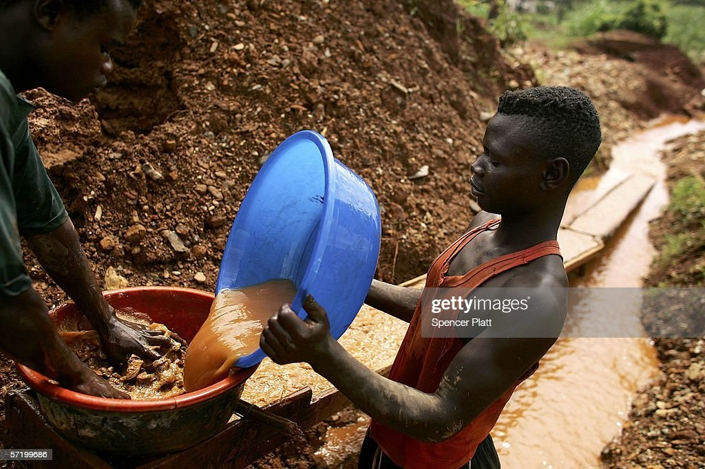 Men sift through dirt and mud while looking for gold March 28, 2006 at an abandoned industrial mine in Mongbwalu, Congo. Thousands of Congolese scrape together meager livings from mining. Gold and other mineral deposits, which are numerous in the volatile north-east of the country, have become a catalyst to much of the conflict in Congo. The Democratic Republic of Congo (DRC), a country that loses an estimated 1,400 people per day due to war since 1998, is struggling to hold Presidential elections this summer. The volatile east of the country, which is situated hundreds of miles from the capital Kinshasa, has been the focal point of continued violence. Numerous militias and warlords have vied for control of the mineral rich eastern Congo for decades, creating instability and continued bloodshed.