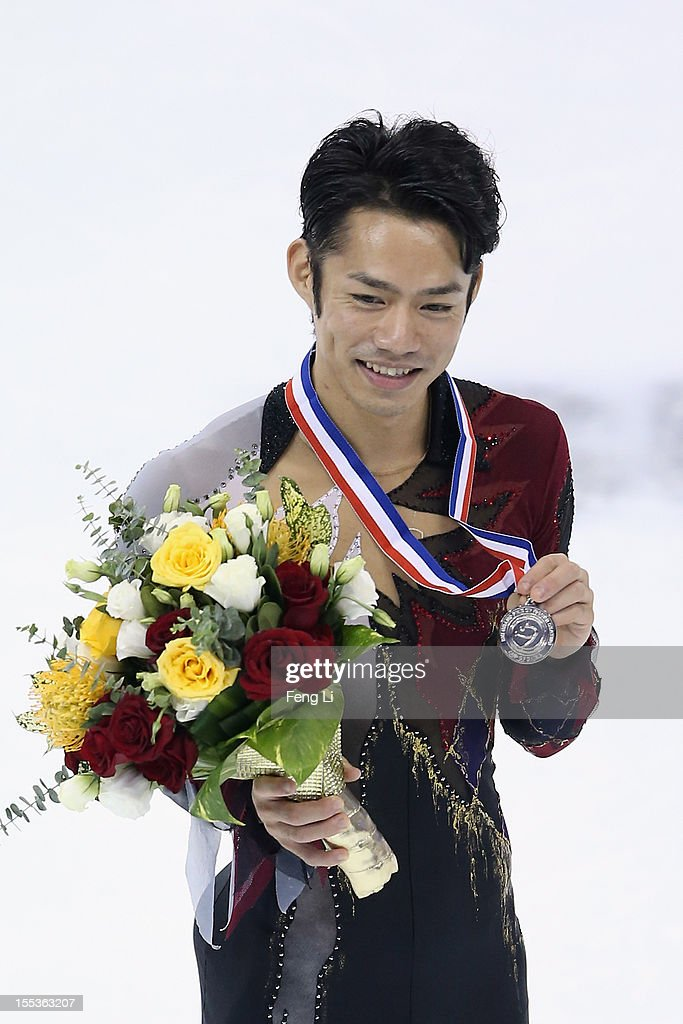 Men silver medalist Daisuke Takahashi of Japan poses for photo during the medal ceremony of Cup of China ISU Grand Prix of Figure Skating 2012 at the Oriental Sports Center on November 3, 2012 in Shanghai, China.
