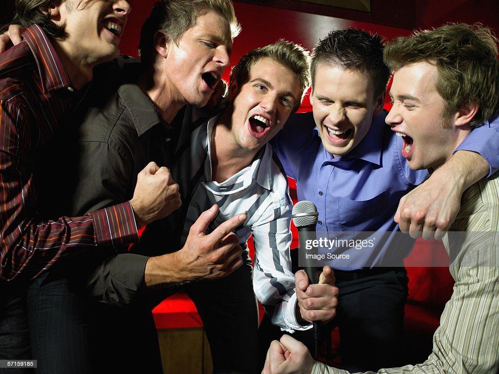 Men singing in a bar