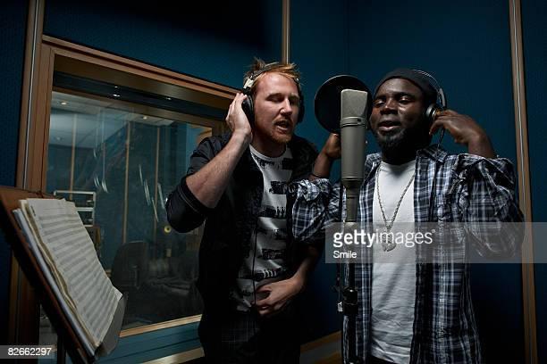 2 men singing in recording studio