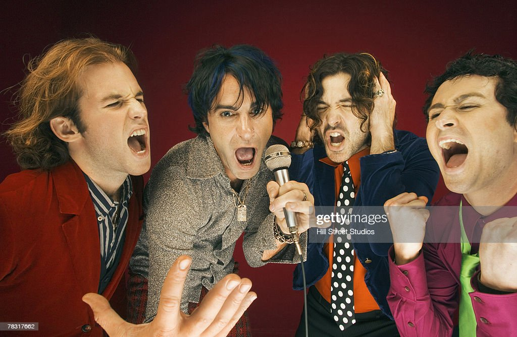 Men singing into microphone : Stock Photo