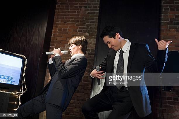 Men singing karaoke