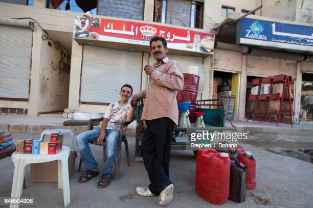 A'ZAZ ALEPPO SYRIA Men sit at a shop in downtown in A'zaz Syria