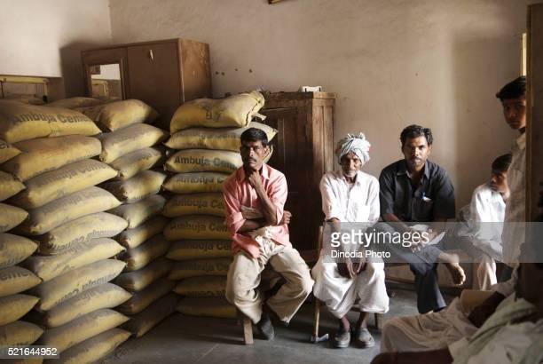 Men sitting in Warehouse Marathwada Maharashtra India Asia