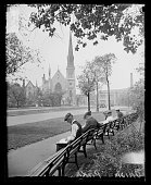 Men sitting near a church in Union Park Chicago Illinois 1929 From the Chicago Daily News negatives collection