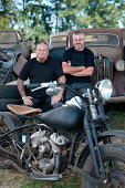 Men sitting with motorcycle
