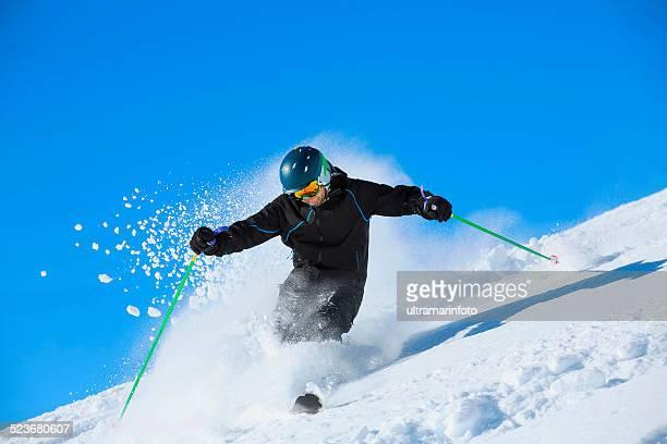 Men skier off piste skiing powder snow   Sunny ski resorts