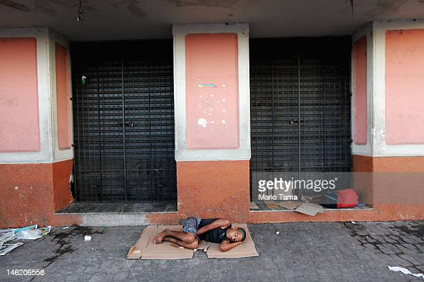 Men sleep outsidethe historic VeroPeso market on June 7 2012 in Belem Brazil Belem is considered the entrance gate to the Amazon and for more than...