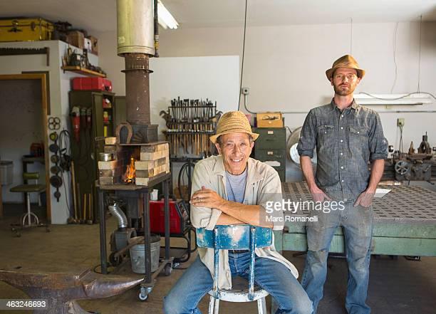 Men smiling in workshop