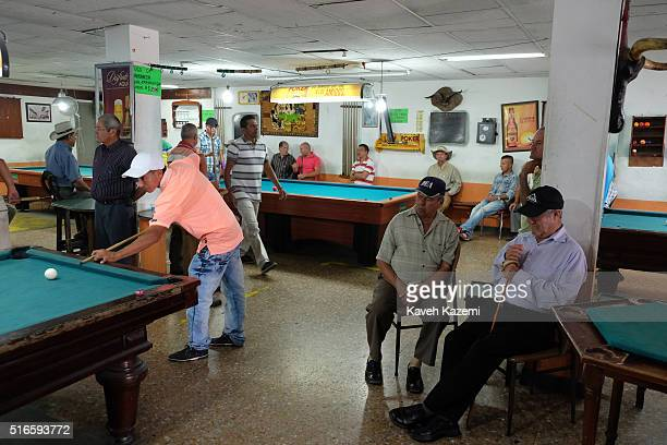 Men spend their Sunday playing pool game in an amusement hall in the main town square on January 24 2016 in Filandia Colombia Filandia is a town and...
