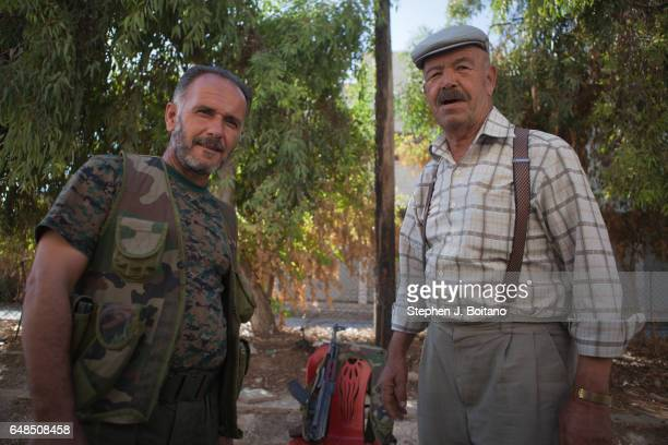 A'ZAZ ALEPPO SYRIA Men stand at a checkpoint to the road south of A'zaz Syria