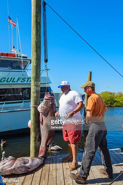 Men Stand by Their Fish Catch in Tarpon Springs Florida