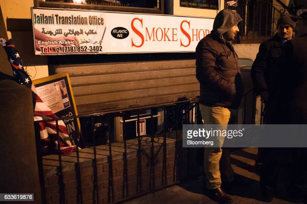 Men stand in front of a Yemeni cafe as bodega owners workers and supporters demonstrate during a strike in New York US on Thursday Feb 2 2017 Bodegas...