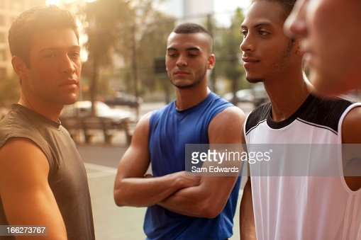 Men standing on basketball court : Stock Photo