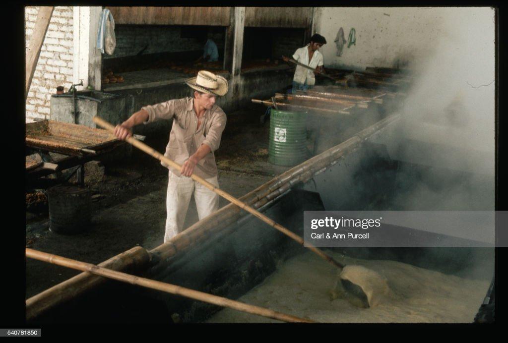 Men Stirring Sugar at Mill