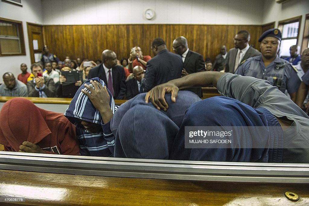 Men suspected of killing Mozambican national Emmanuel Sithole in Alexandra township in an apparent xenophobic attack wear hoods as they are arraigned...