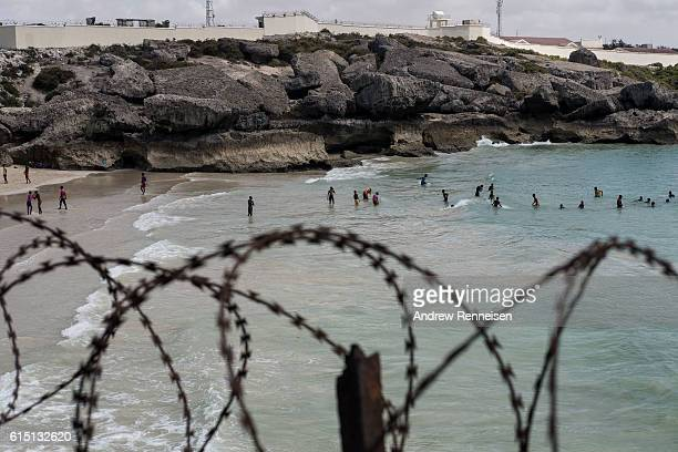 Men swim at a beach outside of the Port of Mogadishu on October 13 2016 in Mogadishu Somalia Somalia is on the brink of its first parliamentary...